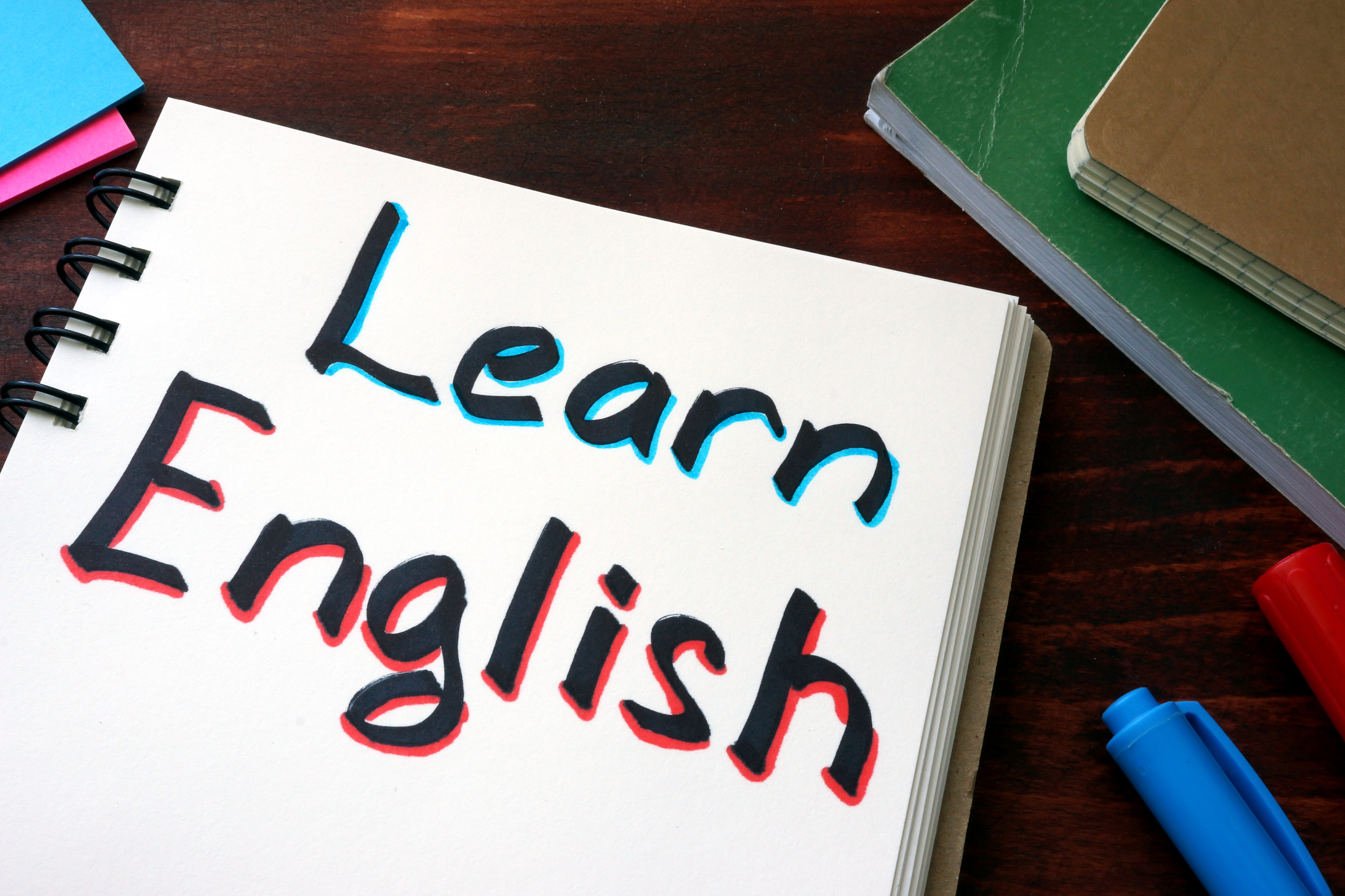Learn English written on a notepad with marker.